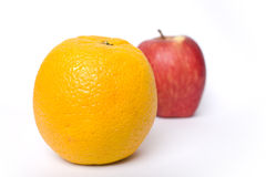Let's Compare Oranges with Apple . . . Royalty Free Stock Image