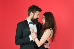 Lets dance tonight. Elegant couple in love tender hug dancing red background. Happy together. Man in tuxedo and woman royalty free stock photography