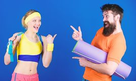 Lets do this. Athletic Success. Strong muscles and body. Sporty couple training with fitness mat and jump rope. Sport royalty free stock photo