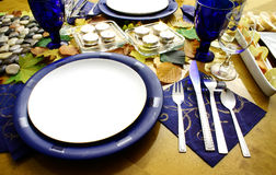 Lets eat. Table covered with autumn leaves and setting plates Royalty Free Stock Images