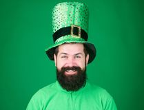 Lets get lucky on st patricks day. Happy bearded man celebrating saint patricks day. Irish man with beard wearing green. Hipster in leprechaun hat and costume royalty free stock photography
