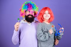 Lets get the party started. Father and daughter in party style wigs. Happy birthday. Happy family celebrating birthday. Father and girl child enjoying birthday royalty free stock photography