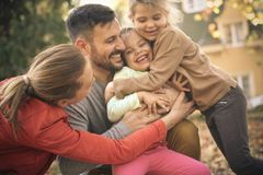 Lets give sister a group hug. Family time. Happy family in hug stock photo