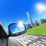 Lets go new year 2015. Drive to city, car and rear view mirror on the road, concept for business, speed or success Stock Photo