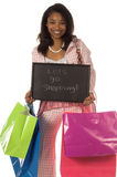Lets Go Shopping!. Beautiful young African American girl Holding colorful shopping bags and a chaulk board sign that says 'Lets Go Shopping royalty free stock images