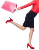 Lets go Shopping. Faceless woman with shopping Bag running Royalty Free Stock Photos