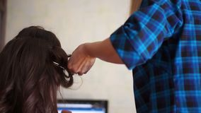 Girl doing her friend`s hair stock video footage