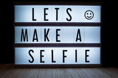 Lets make a selfie. `Lets make a selfie` text in lightbox Royalty Free Stock Photography