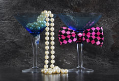 Lets Party male and female cocktail glasses. Royalty Free Stock Image