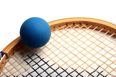 Lets Play. Squash Ball on top of Racket isolated on white Stock Photos