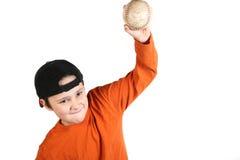 Lets play ball. A cute young man throwing a baseball royalty free stock photos