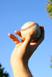 Lets Play Ball. A closeup view of a pitcher throwing his pitch Royalty Free Stock Photography