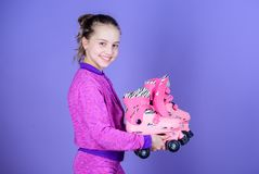 Lets ride. Girl cute little child hold roller skates. Hobby and active leisure. Happy childhood. Pick proper roller. Skates size. Why kids love roller skates stock photo