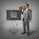 Lets rock text on blackboard with businessman Royalty Free Stock Photo