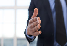 Lets shake hands!. Close-up of African businessman stretching out hand for shaking Royalty Free Stock Photo