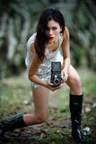 Lets snap a photo. Goth girl holding a twin lens reflex camera stock photo