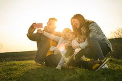 Lets take a group self portrait. Family time. Close u image royalty free stock photography