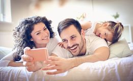 Lets take a photo of our happy family. Family time royalty free stock image