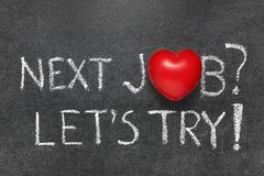 Lets try next job. Concept handwritten on blackboard with heart symbol instead O royalty free stock photo