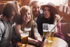 Lets tun einige lustige Gesichter für Foto Stockfotos