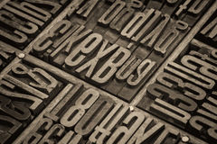Lettepress wood type blocks. Vintage letterpress wood type blocks in a typesetter drawer, retro sepia toned image Stock Images
