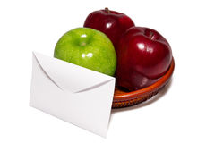 Letter against the apples in a basket. One Letter against three apples in a basket isolated on white Royalty Free Stock Photo