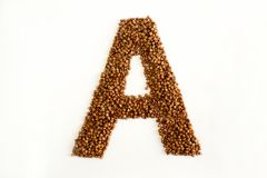 A the letter. alphabet of buckwheat. Porridge. buckwheat grain. concept of healthy eating. photo for your design. horizontalorientation of the sheet stock photography