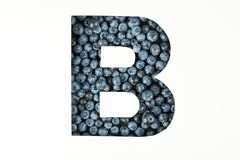 Letter B against blueberries backdrop isolated royalty free stock images