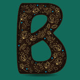 The Letter B with Golden Floral Decor. Dark brown symbol. Yellow flowers and plants with metallic blazing effect. Blue small hearts. Vector Illustration Stock Photos
