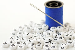 Letter Beads in Close Up Royalty Free Stock Images