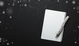 Letter on black background decorated with white flakes. Rustic style, cute paper decoration. Any holiday concept. Royalty Free Stock Photography