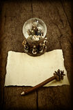 Letter blank parchment on wooden table. Letter blank parchment to write Magi or compliment the Christmas and snow ball with Nativity Scene Stock Image