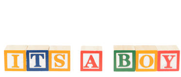 Letter blocks spelling its a boy. Isolated on a white background Stock Photos