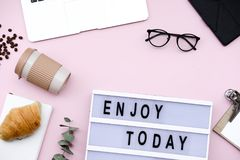 Letter Board Quote with coffee and croissant on pink background. Flat lay, top view still life concept royalty free stock photos
