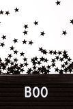 Letter board with word boo. Black letter board with word boo with little stars. Halloween concept stock photos