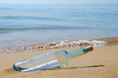 Letter in a bottle. At the sea shore Royalty Free Stock Photo