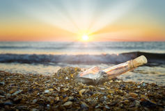 Letter in a bottle. On the beach at sunset Royalty Free Stock Photography