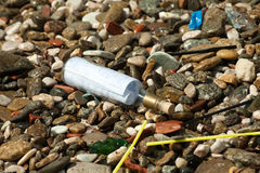 Letter in the bottle. On pebbles beach closeup background Royalty Free Stock Photography