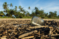 A letter in a bottle. The story of a shipwreck. Write a letter, the last hope, save our souls, tropical coast, palm trees background, registered letter Royalty Free Stock Photography