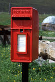 Letter Box. Red british letter box in countryside stock images