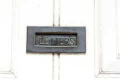 Letter box. Iron letter box on white painted door Royalty Free Stock Photos