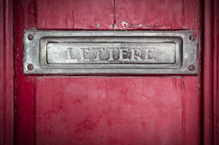 Letter box in a red door Royalty Free Stock Photos