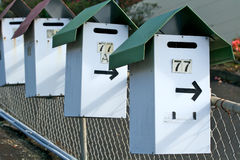 Letter boxes. With the number 77 stock image