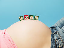 Letter Boxes On Pregnant Woman Belly Royalty Free Stock Photography