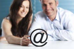 At letter with business woman and man. Royalty Free Stock Image