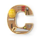 Letter C. Alphabet from the tools on the metal pegboard isolated Stock Images