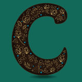 The Letter C with Golden Floral Decor. Dark brown symbol. Yellow flowers and plants with metallic blazing effect. Blue small hearts. Vector Illustration Royalty Free Stock Image