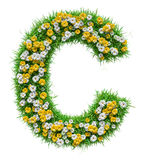 Letter C Of Green Grass And Flowers Royalty Free Stock Photos
