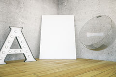 A letter, canvas and chair Stock Photo