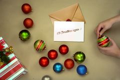Letter and christmas balls, red, blue, green. Decor, ornaments stock image